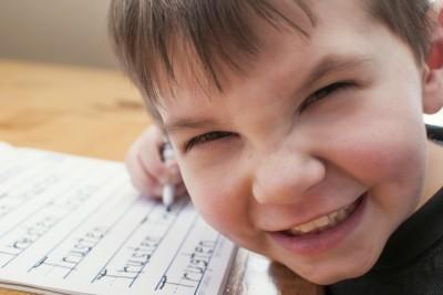 Homeschool boy writing name